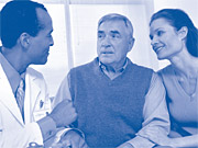 Image of an old man accompanied by his daughter consulting with doctor